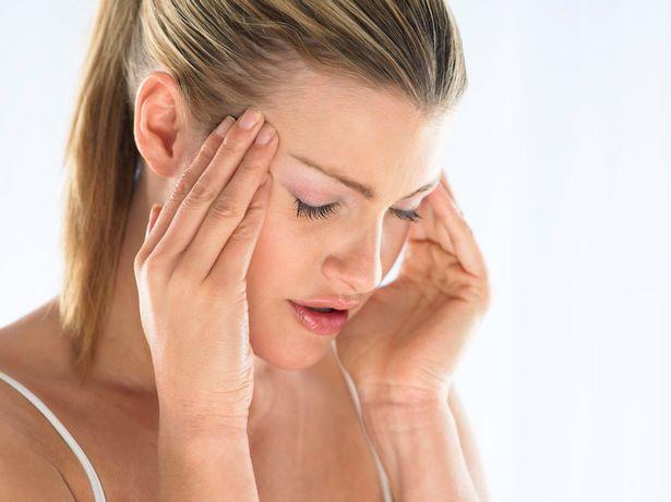 Woman has a headache (1)